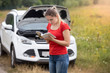 120009897 - Portrait of stressed woman standing at broken car and reading ow © Кирилл Рыжов